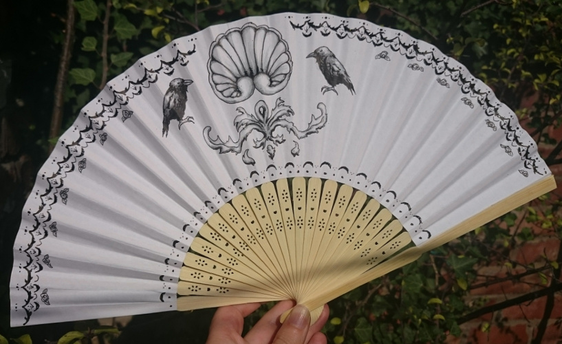 Regency style hand-decorated fan with ravens